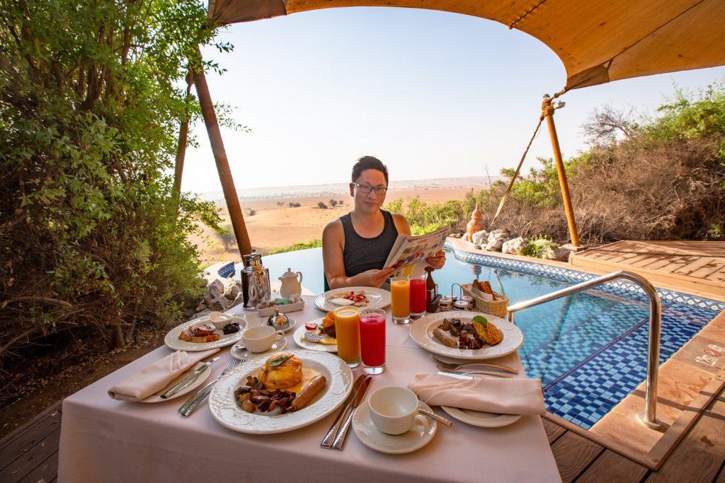 Enjoying breakfast poolside at Al Maha Resort in Dubai.