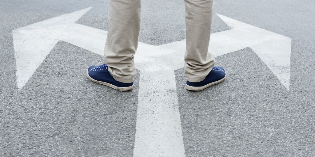 man-standing-hesitating-to-make-decision-picture-id170104934